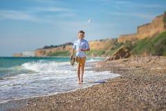 Мальчик моды на пляже Стоковое фото RF