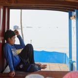 Мальчик на воде, соке Tonle, Камбодже Стоковые Фото