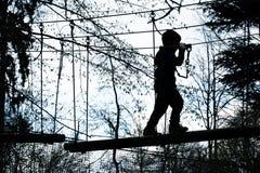 Мальчик на полосе препятствий Стоковые Фото
