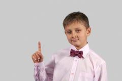 Мальчик на серой предпосылке (04) Стоковая Фотография RF