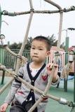 Мальчик на спортивной площадке Стоковые Изображения RF