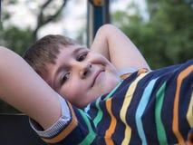Мальчик на спортивной площадке Стоковые Фотографии RF