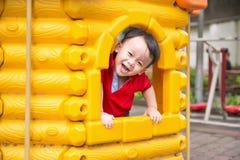 Мальчик на спортивной площадке Стоковая Фотография RF