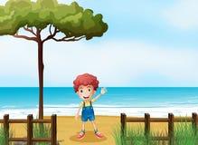 Мальчик на seashore иллюстрация вектора