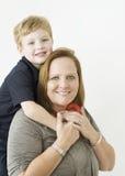 Мальчик обнимая его бабушку ее шеей Стоковое фото RF