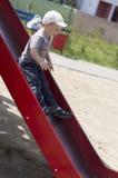 Мальчик освобождает на скольжении Стоковые Фото