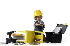 Мальчик одетый как общего назначения работник Стоковые Изображения RF