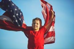 Мальчик патриота с флагом США Стоковое фото RF