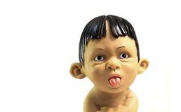 Мальчик показывая язык Стоковое Фото