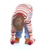 Мальчик поднимает весы Стоковое Фото