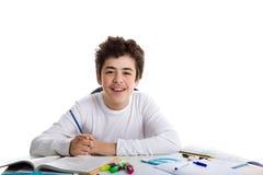 Мальчик подростка делая домашнюю работу Стоковые Фотографии RF