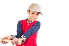 Мальчик принимая бейсбольную биту на белой предпосылке Стоковое фото RF