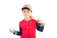 Мальчик принимая бейсбольную биту на белой предпосылке Стоковая Фотография RF