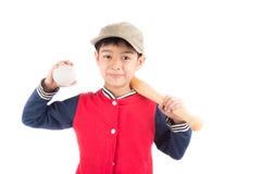 Мальчик принимая бейсбольную биту на белой предпосылке Стоковые Изображения RF