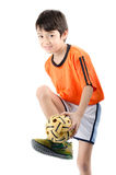 Мальчик принимая takraw sepak на белой предпосылке Стоковое фото RF