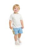 Мальчик при вид спереди кисти стоя во всю длину Стоковое Фото