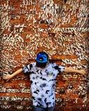 Мальчик против стены Стоковая Фотография RF