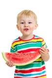 Мальчик ребенка есть изолированный арбуз Стоковая Фотография RF
