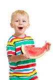 Мальчик ребенк есть изолированный арбуз Стоковая Фотография RF