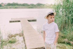 Мальчик рекой и тростником стоковые фотографии rf