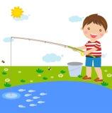 Мальчик рыболовства Стоковые Фото