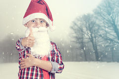 Мальчик Санты на предпосылке зимы Стоковое фото RF