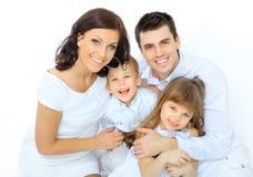Мальчик смеется над с семьей Стоковое Фото