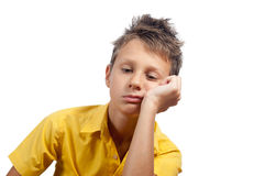 Мальчик смотря пробуренный Все на белой предпосылке Стоковое Изображение RF