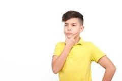 Мальчик смотря смущенный Стоковое Изображение