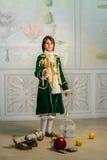 Мальчик стоит в винтажных одеждах Стоковые Изображения