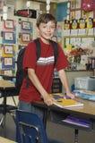 Мальчик стоя в классе Стоковые Фото