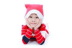 Мальчик счастливого рождеств кладя и усмехаясь Стоковое Изображение RF