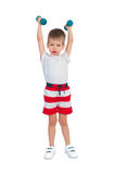 Мальчик с гантелью Стоковое Изображение