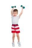 Мальчик с гантелью Стоковые Изображения RF