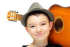 Мальчик с гитарой Стоковое Фото