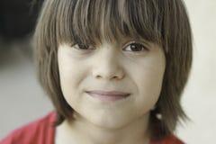 Мальчик с длинными челками Стоковая Фотография RF