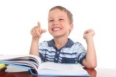 Мальчик с книгой Стоковые Фотографии RF