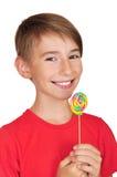 Мальчик с конфетой Стоковая Фотография