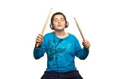 Мальчик с наушниками Стоковое Изображение RF