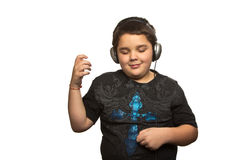 Мальчик с наушниками Стоковое Фото