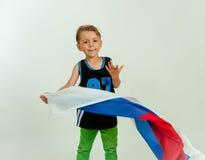 Мальчик с русским флагом стоковое фото rf