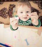 Мальчик с ручкой Стоковые Изображения RF