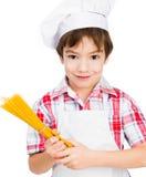 Мальчик с спагетти Стоковое Изображение RF