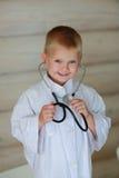 Мальчик с стетоскопом Стоковое Изображение