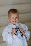 Мальчик с стетоскопом Стоковые Фото