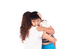 Мальчик унылый в обнимать матери Стоковое фото RF