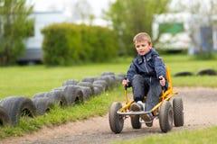 Мальчик управляя автомобилем луны Стоковое фото RF