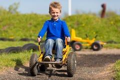 Мальчик управляя автомобилем луны Стоковая Фотография RF