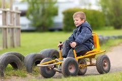 Мальчик управляя автомобилем луны Стоковые Изображения