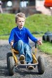 Мальчик управляя багги луны Стоковые Изображения RF